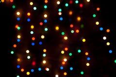 Mehrfarbiges Weihnachtslichter bokeh ist- Stockfotografie