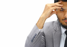 Meia cara séria do homem de negócios novo no fundo branco Imagem de Stock Royalty Free