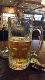 Meia cerveja Fotos de Stock