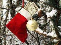 Meia do Natal com conta de dólar Fotografia de Stock