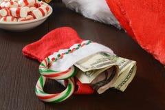 Meia do Natal com dinheiro Fotografia de Stock