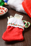 Meia do Natal com dinheiro Imagem de Stock Royalty Free