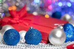 Meia e brinquedos da decoração das bolas do Natal Foto de Stock Royalty Free