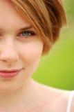 Meia face da mulher Imagem de Stock