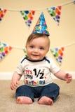 Meia festa de anos de sorriso do bebê feliz Foto de Stock