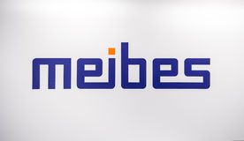 Meibes Sanitary Engineering logo. Sticker letters on the white wall Royalty Free Stock Photo