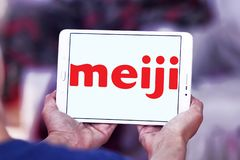 Meiji Holdings logo. Logo of Meiji Holdings company on samsung tablet . the Meiji Group offers a wide range of products including confectioneries, dairy goods Stock Photo