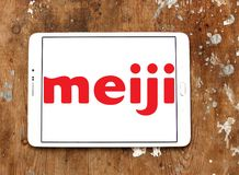 Meiji Holdings logo. Logo of Meiji Holdings company on samsung tablet on wooden background. the Meiji Group offers a wide range of products including Royalty Free Stock Photo