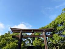 Torri gate to Meiji Jingu, Tokyo. Meiji Jingu is a Shinto shrine in Tokyo, dedicated to the deified spirits of Emperor Meiji and his wife, Empress Shōken stock photo