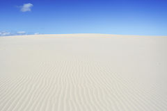 Meilen und Meilen des Sandes am dunklen Punkt Stockbilder