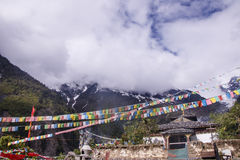 Meili snow Mountain also know as Kawa Karpo located in Yunnan Pr. Ovince, China decorated with colorful prayer flag Royalty Free Stock Photo