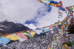 Meili snow Mountain also know as Kawa Karpo located in Yunnan Pr. Ovince, China decorated with colorful prayer flag Royalty Free Stock Photography