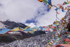 Meili snow Mountain also know as Kawa Karpo located in Yunnan Pr. Ovince, China decorated with colorful prayer flag Stock Photography