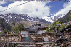 Meili snow Mountain also know as Kawa Karpo located in Yunnan Pr. Ovince, China decorated with colorful prayer flag Stock Photo