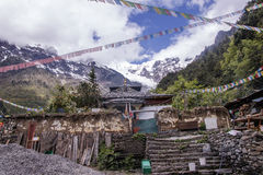 Meili snow Mountain also know as Kawa Karpo located in Yunnan Pr. Ovince, China decorated with colorful prayer flag Royalty Free Stock Images