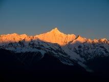 Meili Snow Mountain. Sunrise, golden sun shines on the Meili Snow Mountain royalty free stock photography