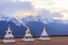 Meili snow mountain and Tibetan stupa, Feilai temple, Deqing, Yunnan, China. Stock Images