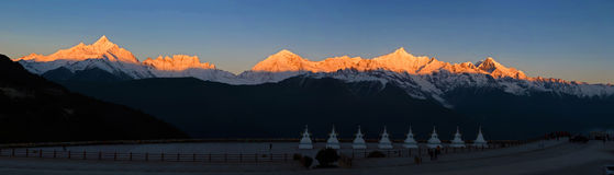 Meili Xue Shan. Panoramic view of Meili Xue Shan, also known as Mainri Snow Mountains at sunset, Yunnan, China royalty free stock photography