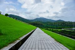 Meilin reservoir, shenzhen city, the middle position of the dam crosswalk. Meilin reservoir is located north of meilin no.1 village, a large residential area in Royalty Free Stock Images