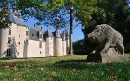 Meillant Chateau. Exterior of Meillant Chateau with wild boar statue in foreground, Cher, Loire Valley, France royalty free stock photography