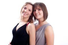 Meilleurs amis ensemble à un arrière-plan blanc. Photos stock