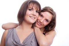 Meilleurs amis ensemble à un arrière-plan blanc. Image stock