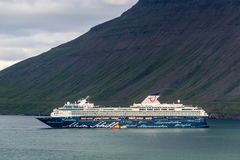 Mein Schiff 2 cruise ship of Tui Cruises company in Iceland. ISAFJORDUR, ICELAND - JULY 7, 2014: Mein Schiff 2 cruise ship of Tui Cruises company departing from Royalty Free Stock Photography
