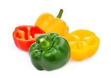 Meio corte da pimenta de sino amarelo, vermelho, verde, doce ou do capsicum Fotografia de Stock Royalty Free