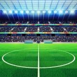 Meio iluminado do estádio de futebol com os fãs nos suportes Foto de Stock Royalty Free