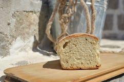 Meio naco de pão caseiro Fotografia de Stock