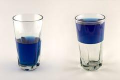 Meio vazio de vidro, meio cheio Fotos de Stock Royalty Free