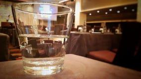 Meio vidro da água Foto de Stock
