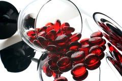 Meios mármores de vidro vermelhos imagem de stock