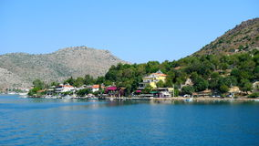 Meis greek island landscapes. Meis Island greece landscapes, houses camouflaged by the trees Stock Photo