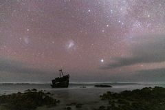Meisho Maru Shipwreck along the Agulhas Coast at the Southern Most tip of Africa and South Africa. Meisho Maru Shipwreck at night under sky of stars along the stock photos