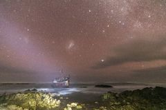 Meisho Maru Shipwreck along the Agulhas Coast at the Southern Most tip of Africa and South Africa. Meisho Maru Shipwreck at night under sky of stars along the royalty free stock photo