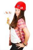 Meisje Ð  in een de bouwhelm met een schildersrol in een hand Stock Afbeeldingen