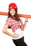 Meisje Ð  in een helm van één kant met het broodje van document Royalty-vrije Stock Afbeeldingen