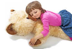 Meisje 3 jaar oude slaap op teddybeer Stock Foto