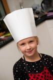 Meisje als jong chef-kokportret Royalty-vrije Stock Foto's