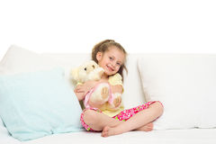 Meisje in bed Stock Afbeeldingen