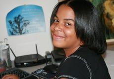 Meisje bij Bureau Stock Foto's