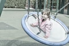 Meisje bij de speelplaats Stock Afbeeldingen