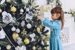 Meisje bij Kerstmis drie stock foto's