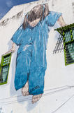 Meisje in Blauwe straatkunst in Penang, Maleisië Royalty-vrije Stock Fotografie