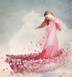 Meisje in boot van bloemen Stock Fotografie