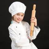 Meisje in chef-kokkostuum Stock Foto