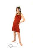 Meisje dat aan Muziek luistert stock afbeeldingen