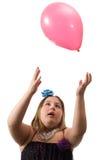 Meisje dat Ballon werpt Stock Afbeeldingen