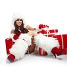 Meisje dat de kleren van de Kerstman draagt stock foto